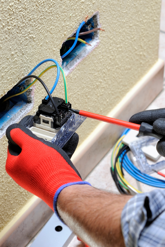 guy installing electrical wires